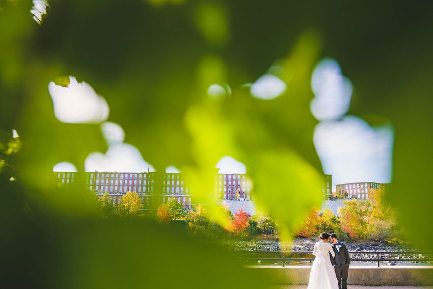 Manchester wedding portrait through trees in Arms Park