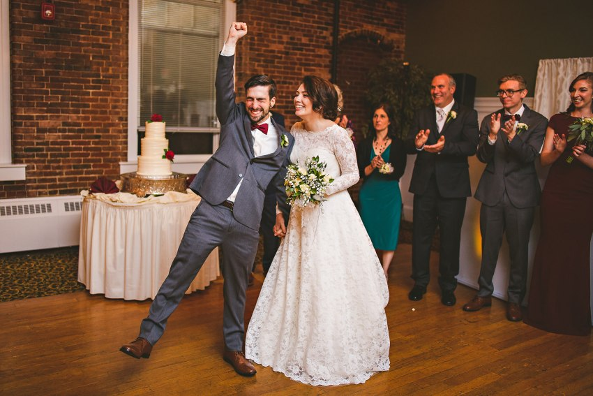 Bride and groom celebrating at reception