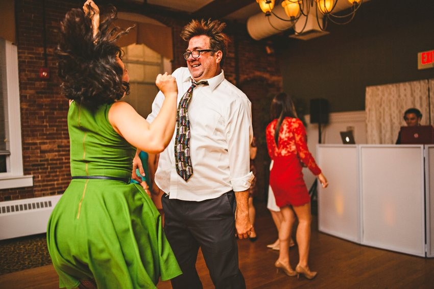 Friends dancing on wedding dancefloor