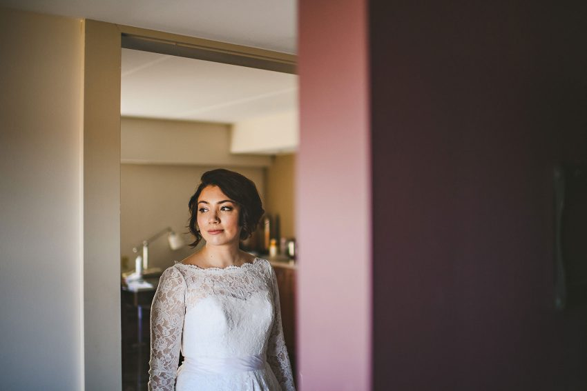 Bride walking through doorframe