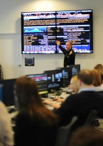 Dr. Al Seaman teaching MCM students about how financial market trading works in our McMaster Trading Floor Simulator.