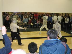 Fred (left) and me, Fencing the honorary first bout at the grand opening of the Dragon Fencing Academy.