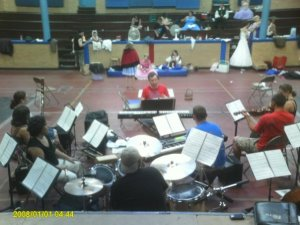 Alex rehearsing the orchestra of Into the Woods in August 2009. Photo by Sara Brennan.