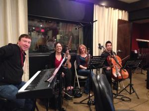 Alex with orchestra members in the recording studio for MMAS's production of Nine, April 2014. Photo by Elana Lorance.