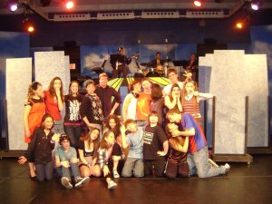 Alex with the cast and band of 13 in April 2010. Photo Courtesy of Mara Wilson.