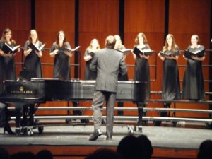 """Alex conducting his arrangement of Ray Charles' """"Hit the Road, Jack"""" with the RIC Women's Choir in May 2009. Photo Courtesy of Tiffany Hervieux."""
