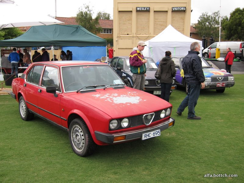 Pictured is the blue Alfetta GCL of team Two Amigos, and the colourful Alfa 90 of team Alfa Will We Get? What a pair of sh*tboxes.