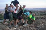reenacting the planting of the flag on Iwo Jima...ended up with eight in the picture instead of seven, and not everybody was kilted. The prototype hash kilt (in hash hunting tartan) is pinned to the guidon.