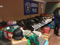 83 weapons, almost 10,000 rounds, a nazi helmet, all recovered from Robert Ivarson's home in Lexington.