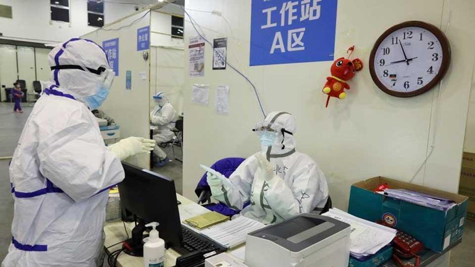 Covid19 en Chine: onze quartiers de Pékin confinés en urgence