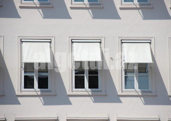depositphotos_55810631-stock-photo-three-windows-on-grey-building