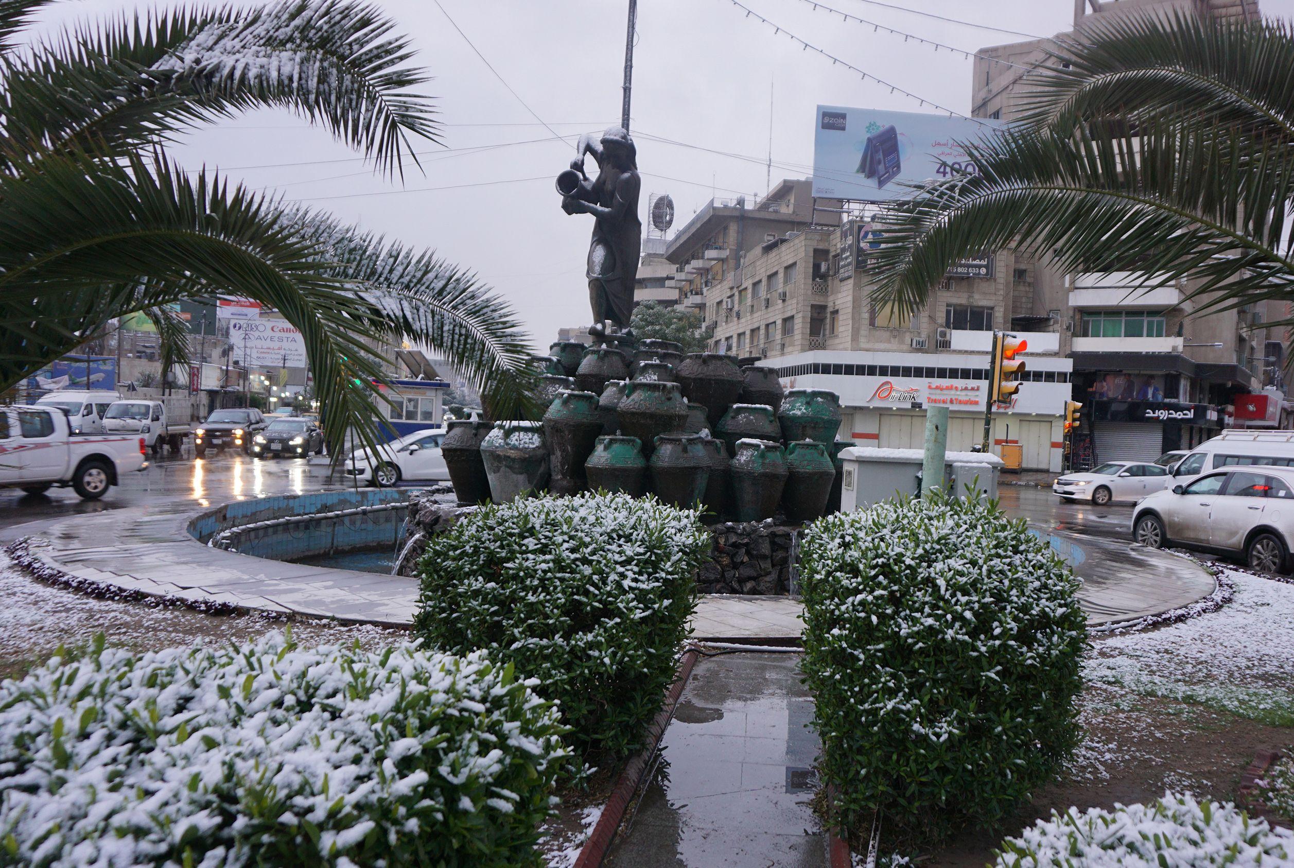 الثلوج تزور بغداد لأول مرة منذ 12 عاما- صور