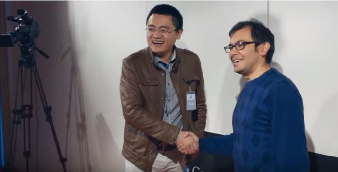 DeepMind's AlphaGo Defeats European Go Champion Fan Hui. Fan Hui with Demis Hassabis