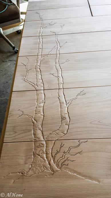 carved aspens on dresser