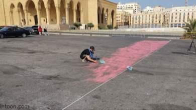 لبناني يرسم أكبر علم لبلاده