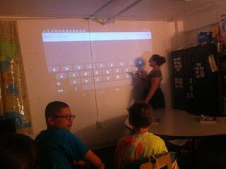 Ms. Mast-Foss is using the stylus to interact directly with the projector, no computer needed!