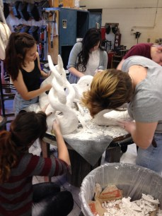 NKU students working on plaster sculptures