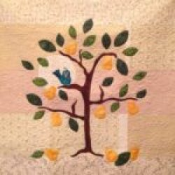 Partridge in a Pear Tree - Wall Hanging with a pieced background and machine appliqué.