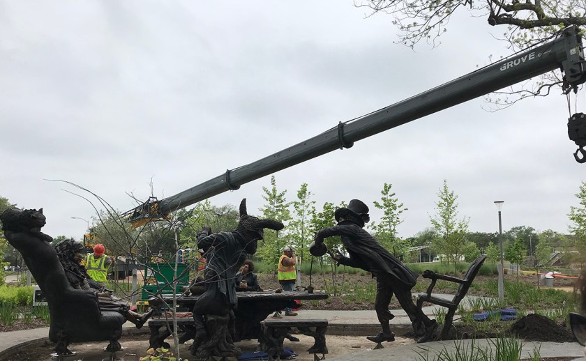 Bronze sculpture installation of Alice In wonderland's Mad Hatter Tea party.