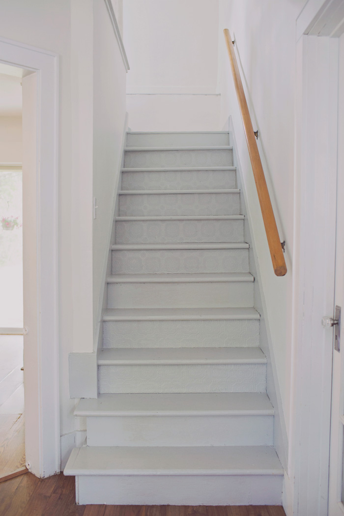 Gray painted stairs with white walls