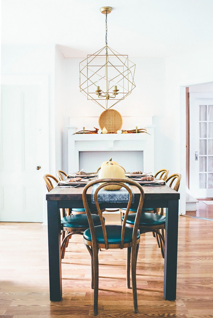 eclectic farmhouse dining room with modern geometric light fixture
