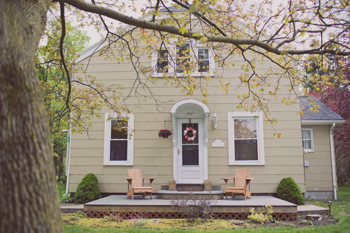 vintage colonial with open front porch decorated to sell