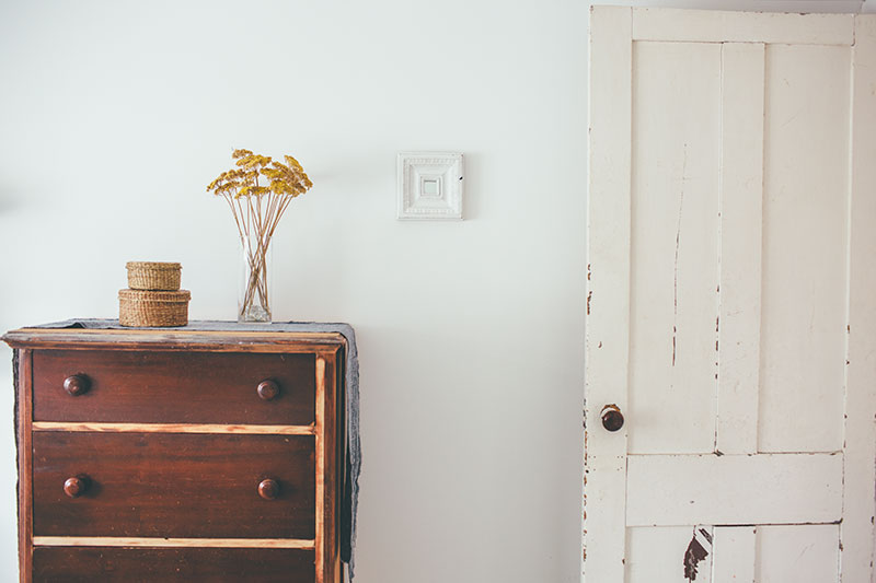 Simple Wooden Dresser in White Bedroom