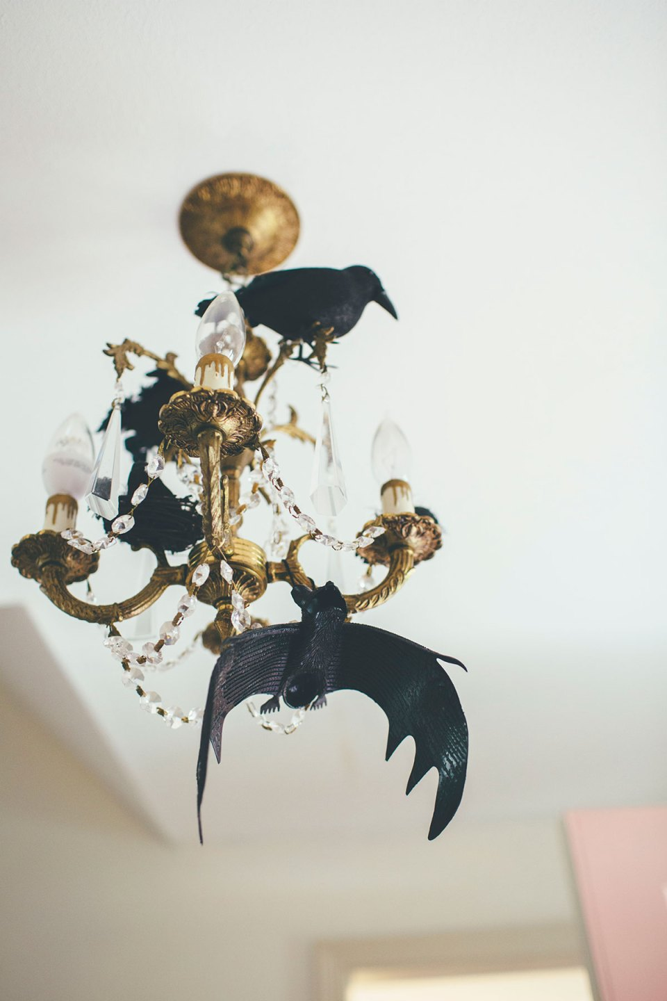 Vintage Chandelier Decorated for Halloween