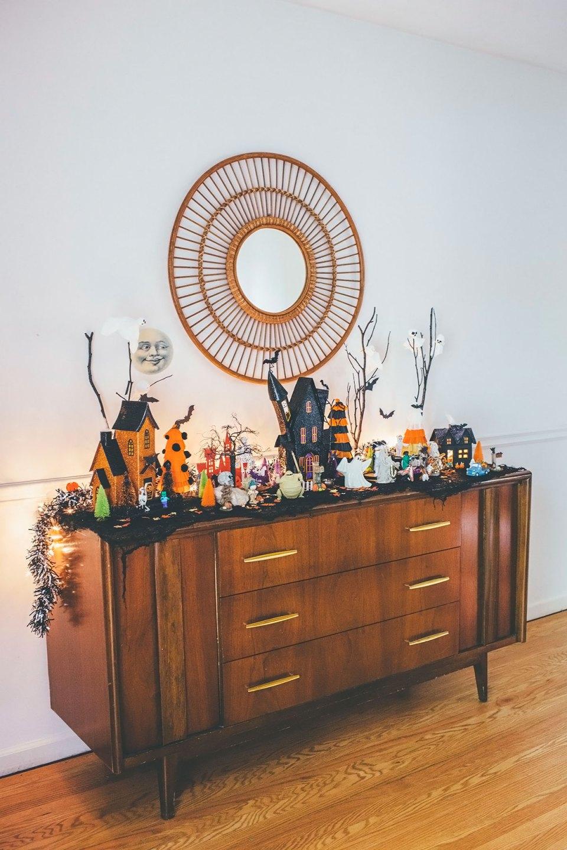 Halloween Village Display on Midcentury Modern Buffet