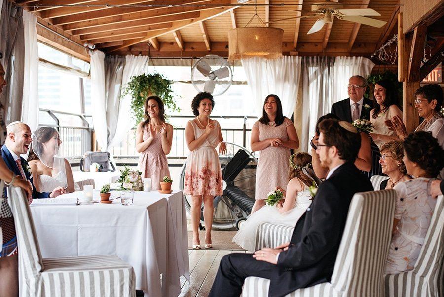 Bridesmaids watching a wedding ceremony