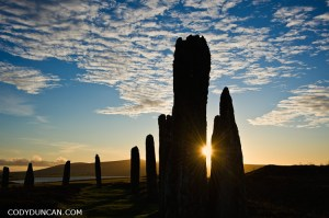Winter sunrise through Ring of Brodgar standing stones, Orkney, Scotland