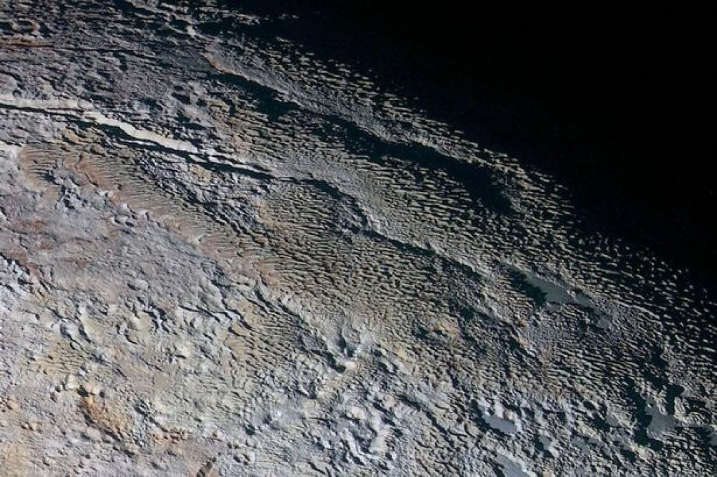 This image shows the geology of Pluto and has been dubbed 'snakeskin' by NASA because of the shape of the rocks
