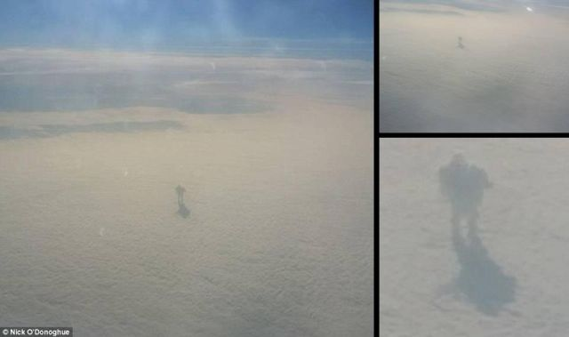 Mysterious shadow figure walking on clouds plane passenger