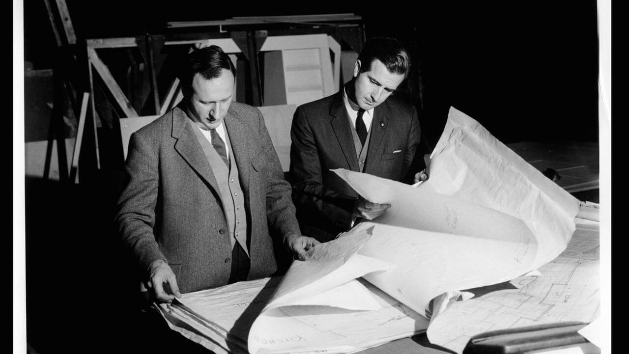 Harry Lange and Frederick I. Ordway III checking designs at MGM Studios in Borehamwood