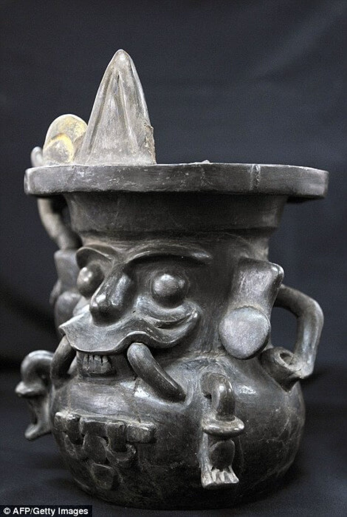 "Handout picture released by the National Institute of Anthropology and History (INAH in Spanish) showing a jar representing the god Tlaloc (God of the Rain), found at the Temple of the Feathered Serpent (Serpiente Emplumada) at the Teotihuacan complex in Mexico City, taken on October 25, 2014. Archaeologist Sergio Gomez announced in a press conference in Mexico City on October 29, 2014 that new discoveries were made recently at the temple. The discovered offering is located at 103 metres from the entrance of the temple and contains thousands of items including 4 stone sculptures and jade ornaments. AFP PHOTO/INAH --- RESTRICTED TO EDITORIAL USE - MANDATORY CREDIT ""AFP PHOTO /INAH"" - NO MARKETING NO ADVERTISING CAMPAIGNS - DISTRIBUTED AS A SERVICE TO CLIENTS--/AFP/Getty Images"