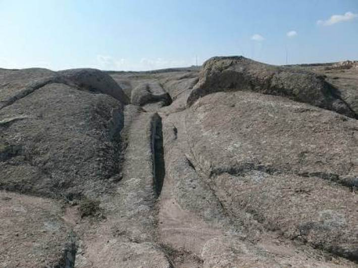 Wheel ruts in stone, in the Phrygian Valley, Turkey. (Courtesy of Dr. Alexander Koltypin)