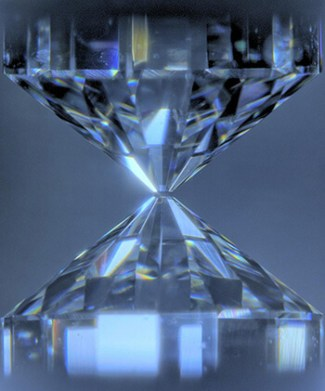 Diamonds to squeeze a sample to ultrahigh pressures corresponding to those of the Earth's core (greater than 135 gigapascals). The samples are heated under pressure to high temperatures of the core (about 4,000 kelvins and higher) by being irradiated by a laser through diamonds.