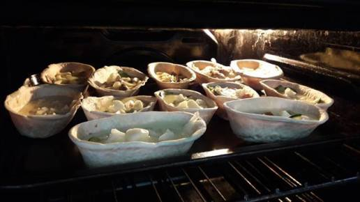 quiches baking in the oven