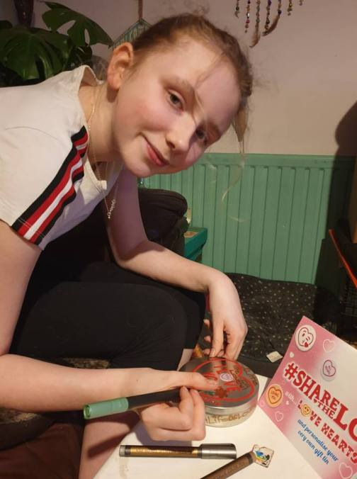 Lissy decorating a tin