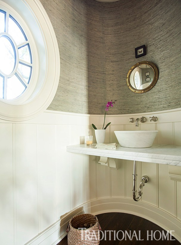 Powder Room with Wainscotting and Wallpapered Walls