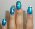 This one I used a wnw fast dry shade in Teal or No Teal, I then used the striping tape and the diamonds to create a geometric manicure.