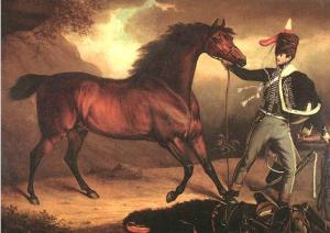 Portrait of a hussar private in 1812, in full uniform and leading a bare-backed horse.
