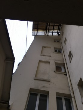 """The view up the """"courtyard"""" opening in by building."""