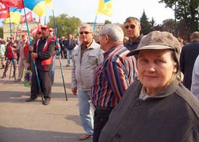"Woman looks to the camera against activists of ""UDAR"" party"