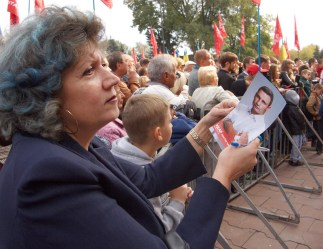 Woman holds a flyer depicting Vitaly Klitschko