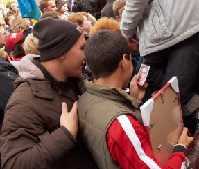 Teens look at the photo of Vitaly Klitschko