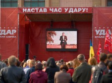 "People watching a promotional film about the ""UDAR of Vitaly Klitschko"" party"