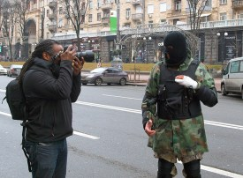 Photograph from England taking a picture of defender of Maidan