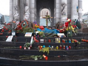 Flowers and candles at the foot of the Monument of Independence where students were beated by the riot police on November 30, 2013