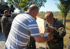 The locals bring ice-cream and pears to soldiers